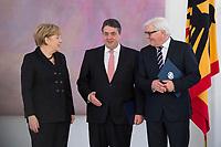 17 DEC 2013, BERLIN/GERMANY:<br /> Angela Merkel (L), CDU, Bundeskanzlerin, und Sigmar Gabriel (M), SPD, Bundeswirtschaftsminister, und Frank-Walter Steinmeier (R), SPD, Bundesaussenminister, im Gespraech, waehrend der Ernennung der Bundesminister des neuen Kabinetts durch den Bundespraesidenten, Schloss Bellevue<br /> IMAGE: 20131217-02-017<br /> KEYWORDS: Gespräch