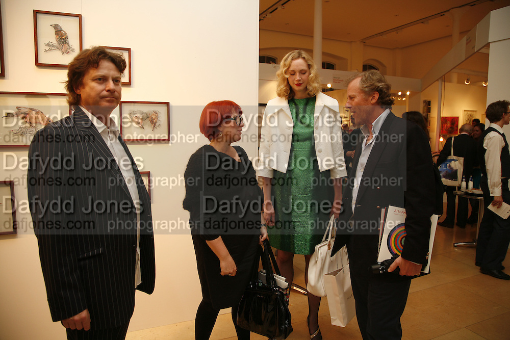 DANNY MOYNIHAN, POLLY MORLAND, GWENDOLINE CHRISTIE AND RICHARD HUDSON, Opening of Photo-London, Burlington Gdns. London. 17 May 2006. ONE TIME USE ONLY - DO NOT ARCHIVE  © Copyright Photograph by Dafydd Jones 66 Stockwell Park Rd. London SW9 0DA Tel 020 7733 0108 www.dafjones.com