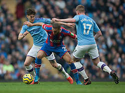 John Stones of Manchester City (L) tackles Cenk Tosun of Crystal Palace (C)  - Mandatory by-line: Jack Phillips/JMP - 18/01/2020 - FOOTBALL - Etihad Stadium - Manchester, England - Manchester City v Crystal Palace - English Premier League
