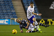Picture by David Horn/Focus Images Ltd +44 7545 970036<br /> 28/01/2014<br /> Steve Morison of Millwall is tackled by Chris Maguire of Sheffield Wednesday during the Sky Bet Championship match at The Den, London.
