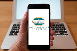 Using iPhone smartphone to display logo of National Bank of Greece