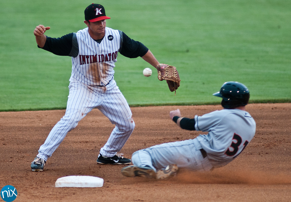 Kannapolis short stop Kyle Eveland bobbles the ball while trying to turn a double play as Delmarva's Michael Rooney slides into second base Wednesday night at Fieldcrest Cannon Stadium. Delmarva won the game 5-3.  (Photo by James Nix)