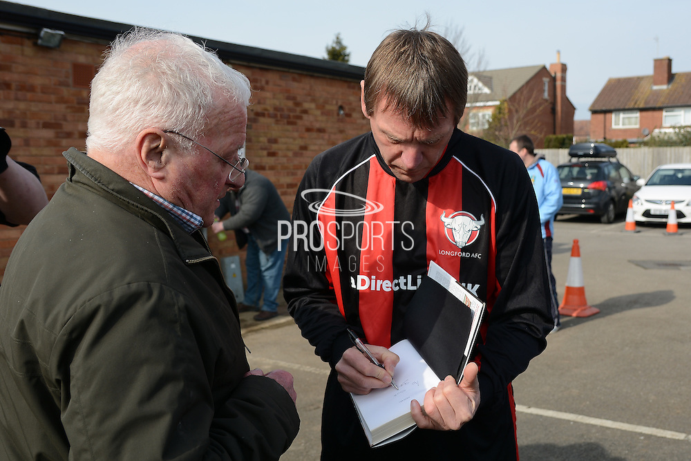 GLOUCESTERSHIRE, ENGLAND – MARCH 12: Stuart Pearce makes his debut for non-league Longford AFC as part of the #directfix campaign by Direct Line. Signing autograph.