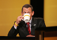 28 August 2007: Seven-time Tour de France winner Lance Armstrong peers over his cup as he takes a drink at the LIVESTRONG Presidential Cancer Forum in Cedar Rapids, Iowa on August 28, 2007.