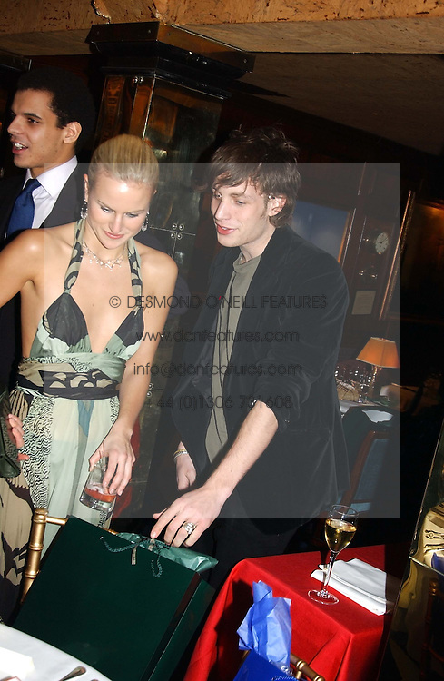 OLYMPIA SCARRY and JAMES JAGGER at a private dinner and presentation of Issa's Autumn-Winter 2005-2006 collection held at Annabel's, 44 Berkeley Square, London on 15th March 2005.<br />