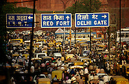 Population. Pollution. Overcrowding. Rush hour traffic jam on Chandni Chowk, the main throughfare of Old Delhi, leading up to the walls of the Red Fort.