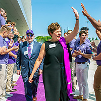 Lou Simpson and Kimberly Querrey arrive at Northwestern University for the dedication of the Walter Athletic Center in Evanston