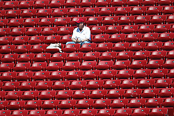 September 4, 2010; Stanford, CA, USA;  A Stanford Cardinal fan sits in empty stands before the game against the Sacramento State Hornets at Stanford Stadium.