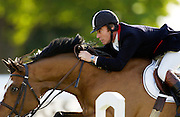 Showjumper Michael Whitaker, British Olympic rider, competes in showjumping competition at Royal Windsor Horse Show, UK