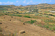 Rural farming landscape view to citadel castle at Victoria Rabat, from near Xaghra island of Gozo, Malta