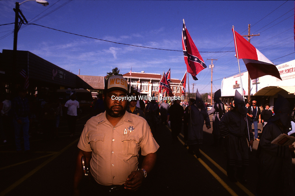 Confederate Knights of the Klu Klux Klan hold a rally and burn a cross in Tylertown, Mississippi.  2/2/1992