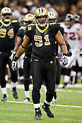 NEW ORLEANS, LA - DECEMBER 26:   Will Smith #91 of the New Orleans Saints walks to the sidelines during a game against the Atlanta Falcons at Mercedes-Benz Superdome on December 26, 2011 in New Orleans, Louisiana.  The Saints defeated the Falcons 45-16.  (Photo by Wesley Hitt/Getty Images) *** Local Caption *** Will Smith