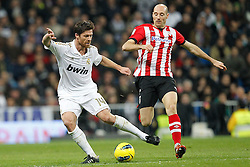 22.01.2012, Santiago Bernabeu Stadion, Madrid, ESP, Primera Division, Real Madrid vs Athletic Bilbao, 1. Spieltag, Nachtrag, im Bild Real Madrid's Xabi Alonso and Athletic de Bilbao's Toquero // during the football match of spanish 'primera divison' league, 1th round, supplement, between Real Madrid and Athletic Bilbao at Santiago Bernabeu stadium, Madrid, Spain on 2012/01/22. EXPA Pictures © 2012, PhotoCredit: EXPA/ Alterphotos/ Cesar Cebolla..***** ATTENTION - OUT OF ESP and SUI *****