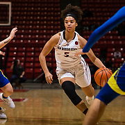 24 February 2018: The San Diego State women's basketball team closes out it's home schedule of the regular season Saturday afternoon against San Jose State. San Diego State Aztecs guard Te'a Adams (5) looks to drive the ball into the paint through San Jose State defenders in the first half.  At halftime the Aztecs lead the Spartans 36-33 at Viejas Arena.<br /> More game action at sdsuaztecphotos.com