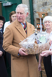 Prince Charles today visited the village of Sherston, Wilts. He met up with projects supporting rural life, which are supported by the Prince's Countryside Fund. He met locals, and received a Christmas Hamper as a gift. Sherston, United Kingdom. Monday, 25th November 2013. Picture by i-Images