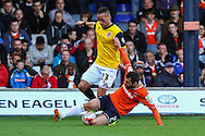 Alex Lawless of Luton Town tackels Kaid Mohamed of Northampton Town during the Sky Bet League 2 match at Kenilworth Road, Luton<br /> Picture by David Horn/Focus Images Ltd +44 7545 970036<br /> 25/10/2014