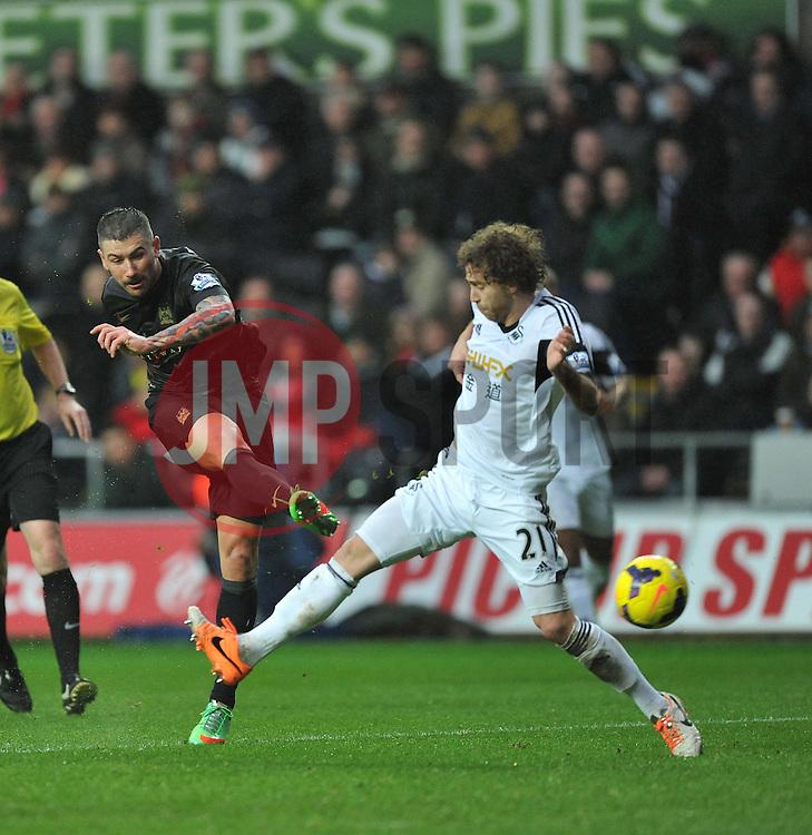 Manchester City's Aleksandar Kolarov scores the third goal of the game. - Photo mandatory by-line: Alex James/JMP - Tel: Mobile: 07966 386802 01/01/2014 - SPORT - FOOTBALL - Liberty Stadium - Swansea - Swansea City v Manchester City - Barclays Premier League