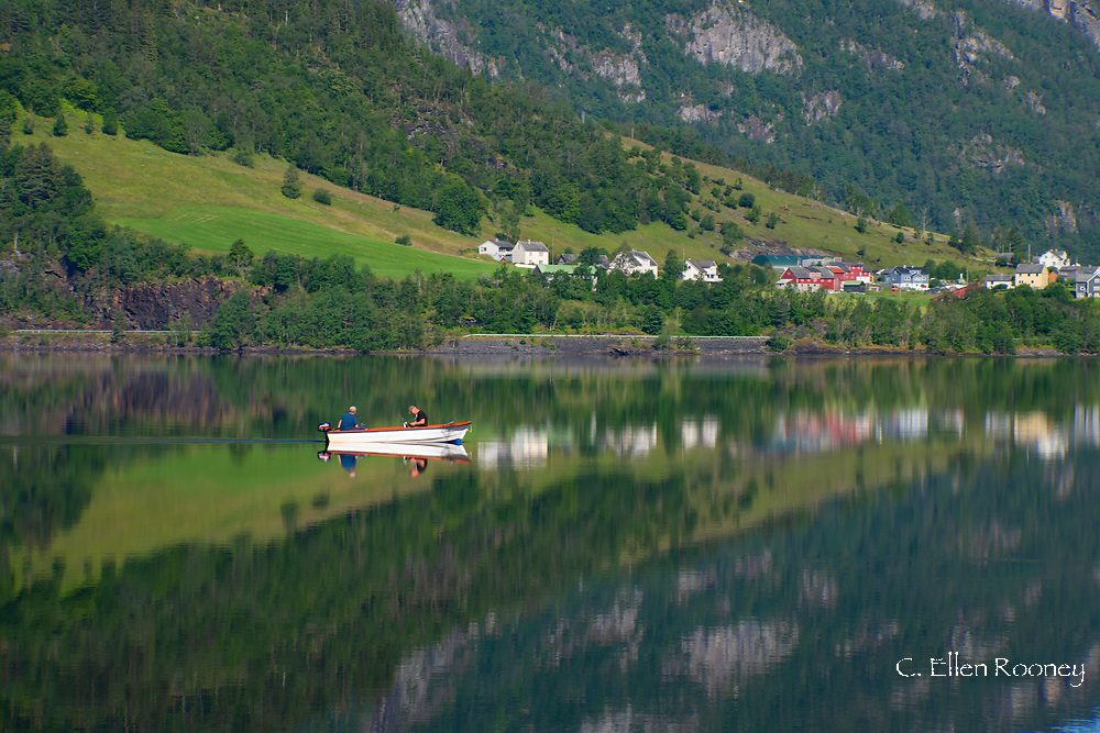 Fishermen in a small boat on Lake Granvinvatnet, Hordaland, Vestlandet, Norway, Europe