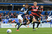 Birmingham City midfielder Demarai Gray tracked by Queens Park Rangers defender Paul Konchesky during the Sky Bet Championship match between Birmingham City and Queens Park Rangers at St Andrews, Birmingham, England on 17 October 2015. Photo by Alan Franklin.