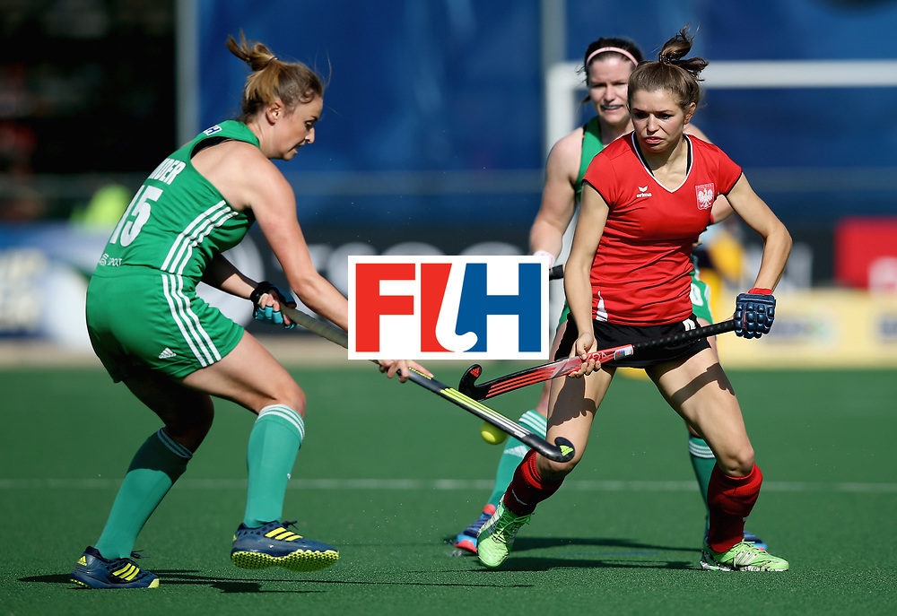 JOHANNESBURG, SOUTH AFRICA - JULY 12: Gillian Pinder of Ireland and Amelia Katerla of Poland battle for possession during day 3 of the FIH Hockey World League Semi Finals Pool A match between Ireland and Poland at Wits University on July 12, 2017 in Johannesburg, South Africa. (Photo by Jan Kruger/Getty Images for FIH)