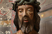 Le Christ aux outrages, detail of face, sculpture in polychrome wood, 16th century, depicting Christ, hands bound and wearing the crown of thorns, waiting for crucifixion after being beaten and humiliated, in the chevet of the Cathedral Saint-Samson, begun in the 13th century on the site of an older church and completed in the 18th century, in Dol-de-Bretagne, Brittany, France. The cathedral is dedicated to one of the founding saints of Brittany and until 1801 was the seat of the archbishopric of Dol. Picture by Manuel Cohen