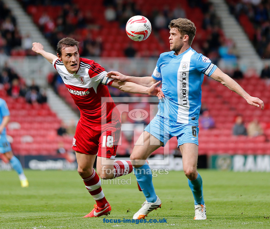 Dean Whitehead of Middlesbrough and Martin Cranie of Barnsley during the Sky Bet Championship match at the Riverside Stadium, Middlesbrough<br /> Picture by Simon Moore/Focus Images Ltd 07807 671782<br /> 26/04/2014