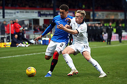 Rangers' James Tavernier (left) and Dundee's Calvin Miller battle for the ball during the Scottish Premiership match at Dens Park, Dundee.