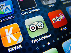 detail of iPhone 4G screen showing Tripadvisor customer reviews app