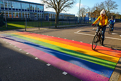 © Licensed to London News Pictures. 11/02/2020. London, UK. A cyclist rides over a LGBT rainbow-coloured crossing outside a school in north London, which is installed in celebration of LGBT History Month. The school, which is the first one in England to have a rainbow coloured crossing outside a school, claims that it has received around 200 abusive messages on social media. Photo credit: Dinendra Haria/LNP