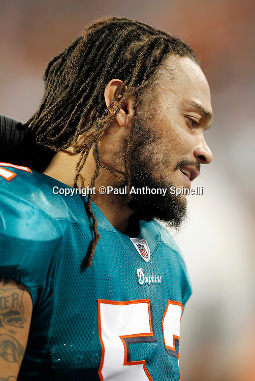 Miami Dolphins linebacker Channing Crowder (52) chats on the sidelines during the NFL week 11 football game against the Chicago Bears on Thursday, November 18, 2010 in Miami Gardens, Florida. The Bears won the game 16-0. (©Paul Anthony Spinelli)