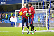 David De Gea of Manchester United and Sergio Romero Goalkeeper of Manchester United in the warm up during the Barclays Premier League match between Chelsea and Manchester United at Stamford Bridge, London, England on 7 February 2016. Photo by Phil Duncan.