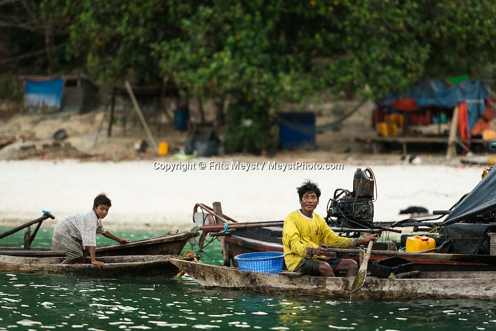 St Johns Island, Mergui Archipelago, Myanmar, April 2016.  an indigenous Moken family on their boats. The sea gipsies are nomadic and live mostly on their longtail boats, living of small scale fishery. Project Manaia researches the Mergui Archipelago, Myanmar to help protect this remote island group for future generations and keep it as pristine as it is now. Manaia aims to provide a platform for independent scientists as well as camera teams to get them on the location for documentation and scientific work on Climate change issues, ocean acidification, plastic gyres and others. Photo by Frits Meyst / MeystPhoto.com