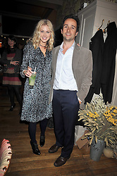 DONNA AIR and MATT HERMER owner of Boujis at a dinner in aid of the Soil Association held at Bumpkin, 102 Old Brompton Road, London SW7 on 11th March 2009.
