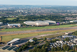 © Licensed to London News Pictures. 29/07/2019; Bristol, UK. The Brabazon hanger at Filton Airfield. Malaysian company YTL Developments are proposing to build a new 16,000 seater 'Bristol Arena' for concerts and events in the Brabazon hangers, and Filton Airfield is to be redeveloped for housing by YTL. The new Brabazon neighbourhood will eventually have thousands of new homes, schools, health centre, university campus and employment space. After the Second World War, the concrete runway at Filton Aerodrome was extended to enable the huge Bristol Brabazon airliner to take off safely. The three-bay Brabazon Hangar was built in the late 1940s and the hangar doors were the largest in the world at the time. After a worker was crushed and killed while taking a sleep in one of the folds of the hangar doors, a siren was installed to warn employees when the doors were being operated. Photo credit: Simon Chapman/LNP.