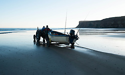 © Licensed to London News Pictures. 11/03/2014<br /> <br /> Saltburn by the Sea, England<br /> <br /> Local fishermen prepare to launch their boat as dawn breaks over the beach in Saltburn by the Sea in Cleveland.<br /> <br /> Photo credit : Ian Forsyth/LNP