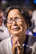 "04 FEBRUARY 2013 - PHNOM PENH, CAMBODIA:  A Cambodian woman cries out at the cremation of their former King Norodom Sihanouk during the King-Father's cremation service in Phnom Penh. Norodom Sihanouk (31 October 1922 - 15 October 2012) was the King of Cambodia from 1941 to 1955 and again from 1993 to 2004. He was the effective ruler of Cambodia from 1953 to 1970. After his second abdication in 2004, he was given the honorific of ""The King-Father of Cambodia."" Sihanouk died in Beijing, China, where he was receiving medical care, on Oct. 15, 2012.   PHOTO BY JACK KURTZ"