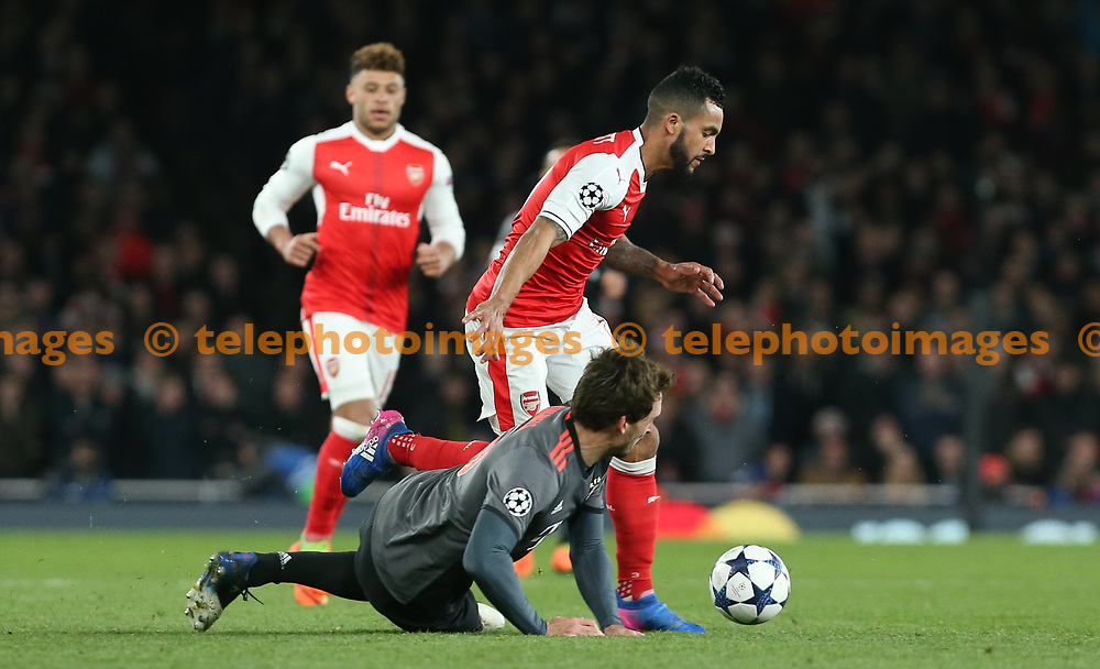 Theo Walcott of Arsenal evades a challenge from Mats Hummels of Bayern Munich during the UEFA Champions League match between Arsenal and Bayern Munchen at the Emirates Stadium in London. March 7, 2017.<br /> Arron Gent / Telephoto Images<br /> +44 7967 642437