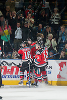 KELOWNA, CANADA - OCTOBER 25: Colten Martin #8, Kris Schmidli #16, Riley Stadel #3 and Cole Linaker #26 of Kelowna Rockets celebrate a goal against the Brandon Wheat Kings on October 25, 2014 at Prospera Place in Kelowna, British Columbia, Canada.  (Photo by Marissa Baecker/Shoot the Breeze)  *** Local Caption *** Colten Martin; Kris Schmidli; Riley Stadel; Cole Linaker;