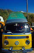 Surfers' VW camper van roof up Fistral beach Newquay UK May 2002