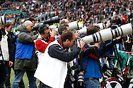 Photographers take pictures of Prince Harry before the Investec series international between England and the New Zealand All Blacks at Twickenham, London, Looks on Saturday 6th November 2010. (Photo by Andrew Tobin/SLIK images)