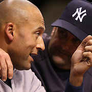 New York Yankees shortstop Derek Jeter (2) is seen talking in the Yankees dugout during a major league baseball game between the New York Yankees and the Tampa Bay Rays at Tropicana Field on Thursday, Sept. 17, 2014 in St. Petersburg, Florida. The Yankees won the game 3-2 and this was Jeter's last game against Tampa Bay. (AP Photo/Alex Menendez)