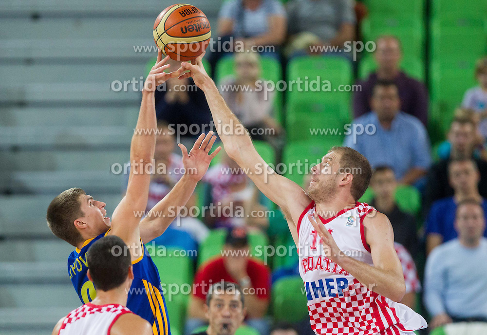 Oleksandr Lypovyy #9 of Ukraine vs Luka Zoric #14 of Croatia during basketball match between National teams of Croatia and Ukraine in Quarterfinals at Day 16 of Eurobasket 2013 on September 19, 2013 in Arena Stozice, Ljubljana, Slovenia. (Photo by Vid Ponikvar / Sportida.com)