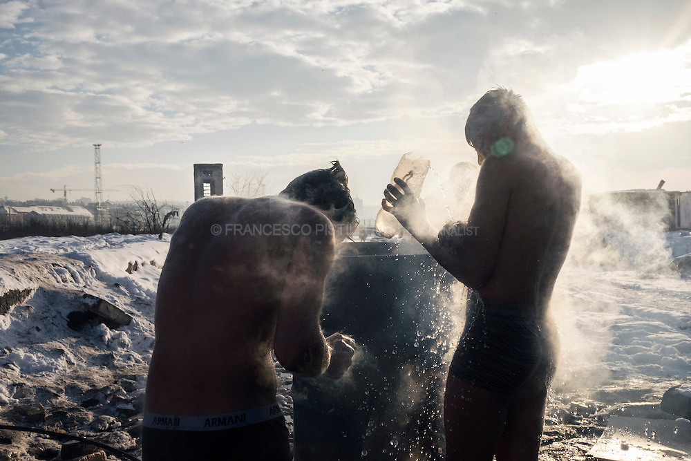 Afghan refugees washing theirself outside of a derelict warehouse in Belgrade. Up to 1500 migrants are trying to survive the freezing Serbian winter in a crumbling building with broken windows, no electricity, no heating, or water. They are surviving without sanitation and in a sub-zero winter.