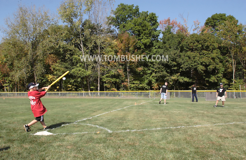 Scotchtown, New York - A boy hits the ball during the Wiffle for Kids charity Wiffle Ball tournament at the Town of Wallkill Little League fields on Sept. 25, 2010.
