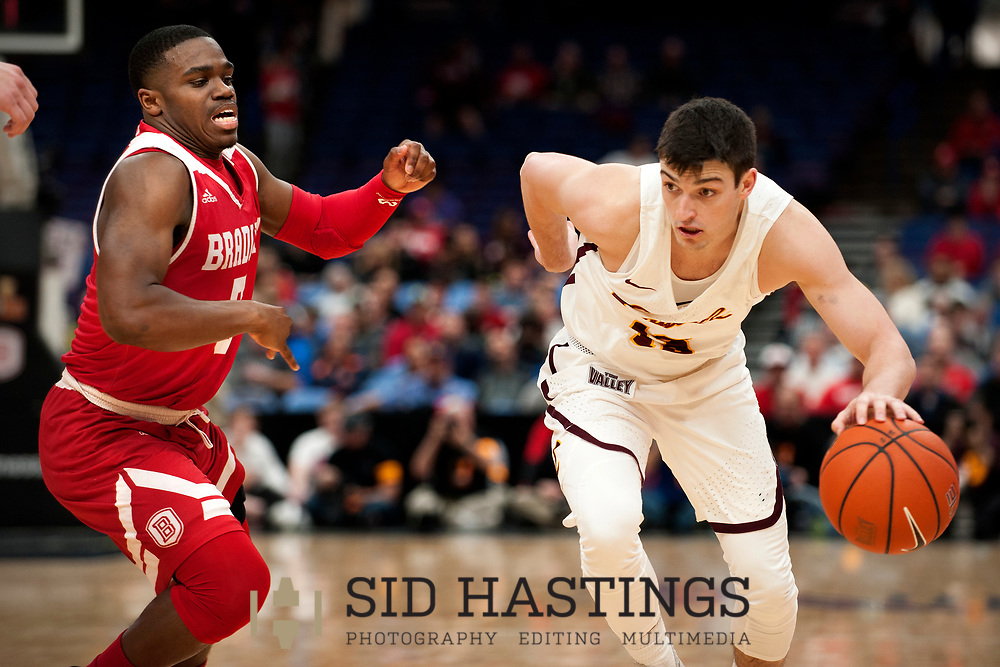 Loyola University Chicago basketball player Clayton Custer (13) drives against Bradley University's Darrell Brown (5) during the semifinals of the Missouri Valley Conference men's basketball tournament at Scottrade Center in St. Louis Saturday, March 3, 2018. LUC won, 62-54. Photo © copyright 2018 Sid Hastings.