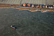 Nederland, Noord-Holland, Durgerdam, 10-01-2009; Buiten-IJ, scheepje vastgevroren in het ijs van het IJsselmeer, ter hoogte van de Durgerdammerdijk (Amsterdam-Noord).ship found frozen in the ice of the lake, at the Durgerdammerdijk (north of Amsterdam-Noord).ijs, natuurijs, winter, koud, vriezen, min nul, beneden nul, koud, celsius, ice, snow, cold, freezing, minus zero, below zero, cold, winterlandschap, winter landscape. .luchtfoto (toeslag); aerial photo (additional fee required); .foto Siebe Swart / photo Siebe Swart