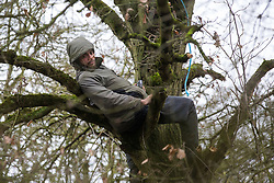 Harefield, UK. 14 January, 2020. Stop HS2 activist Freeman takes refuge in a tree as enforcement agents working on behalf of HS2 attempt to evict activists from a protection camp close to Harvil Road. Part of the nearby Harvil Road protection camp was evicted by bailiffs last week. 108 ancient woodlands are set to be destroyed by the high-speed rail link and further destruction of trees for HS2 in the Harvil Road area is believed to be imminent.