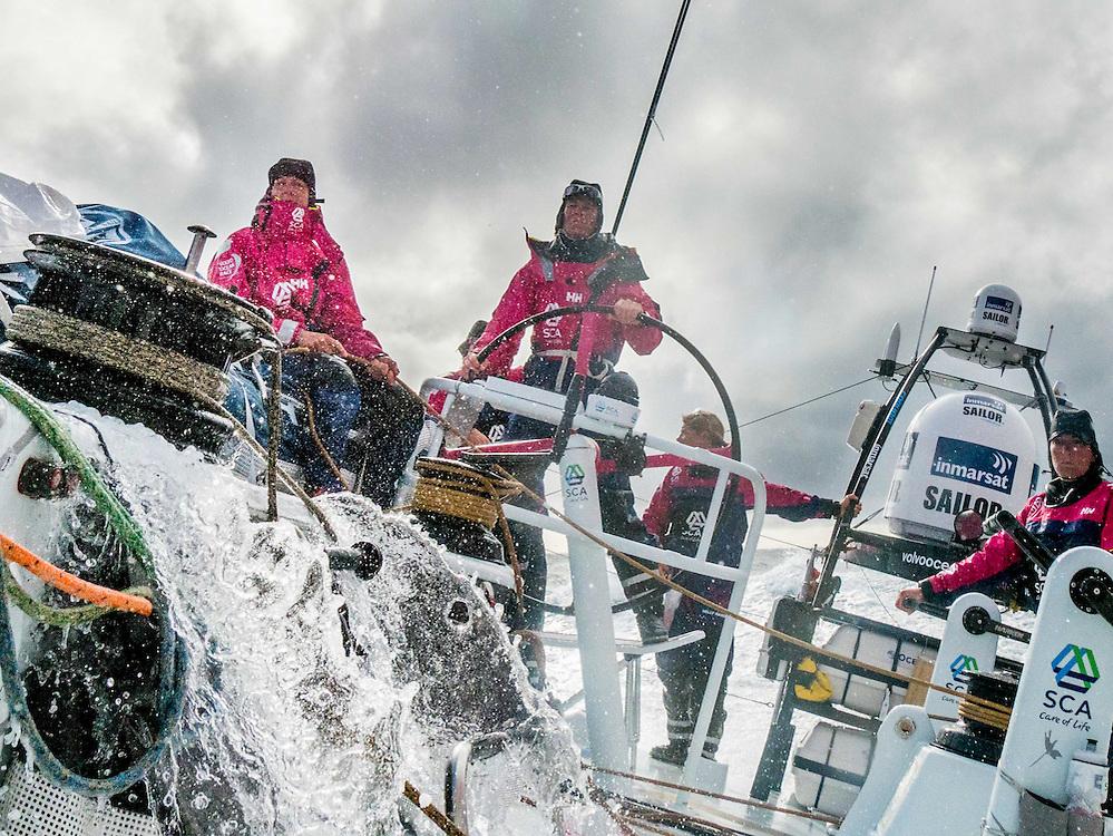 "November 22, 2014. Leg 2 onboard Team SCA. Carolijn ""Gyro"" Brouwer helms as the waves pick up."
