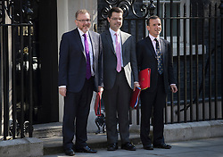 © Licensed to London News Pictures. 19/07/2016. London, UK. Secretaries of State for (L-R) Scotland, Northern Ireland and Wales - David Mundell, James Brokenshire and Alun Cairns arrive together in Downing Street for Prime Minister Theresa May's first cabinet.  Photo credit: Peter Macdiarmid/LNP