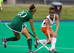 August 29, 2008 - CHARLOTTESVILLE, VA -  Virginia Cavaliers midfielder Shelly Edmonds (4) and William and Mary Tribe midfielder/forward Sarah Louie (20) battle for possession.  The Virginia Cavaliers field hockey team defeated the William and Mary Tribe 5-0 on the University Hall Turf Field on the Grounds of the University of Virginia in Charlottesville, VA.